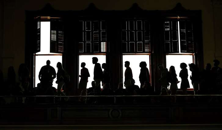 """Students file into the Senate Chamber before the final vote on an anti-""""sanctuary cities"""" bill, Wednesday, Feb. 8, 2017, in Austin. (AP Photo/Eric Gay)"""