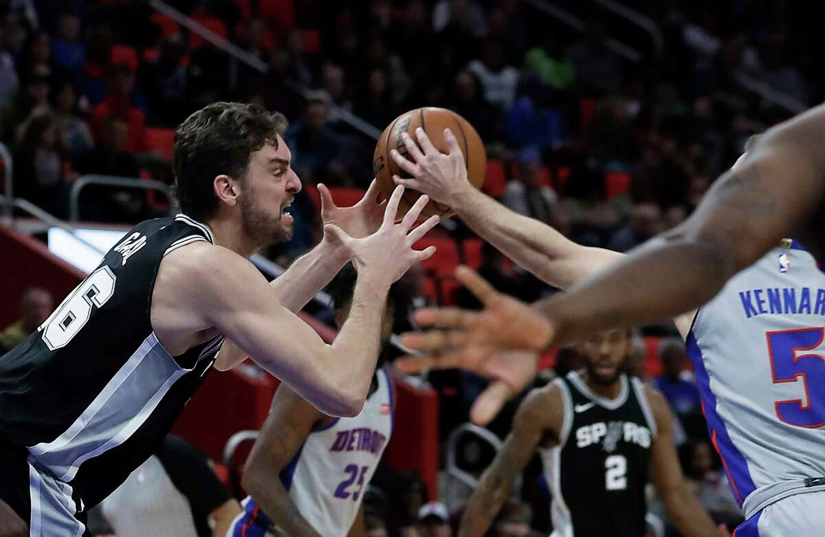 Detroit Pistons guard Luke Kennard (5) steals the ball away from San Antonio Spurs center Pau Gasol (16) during the first half of an NBA basketball game, Saturday, Dec. 30, 2017, in Detroit. (AP Photo/Carlos Osorio)
