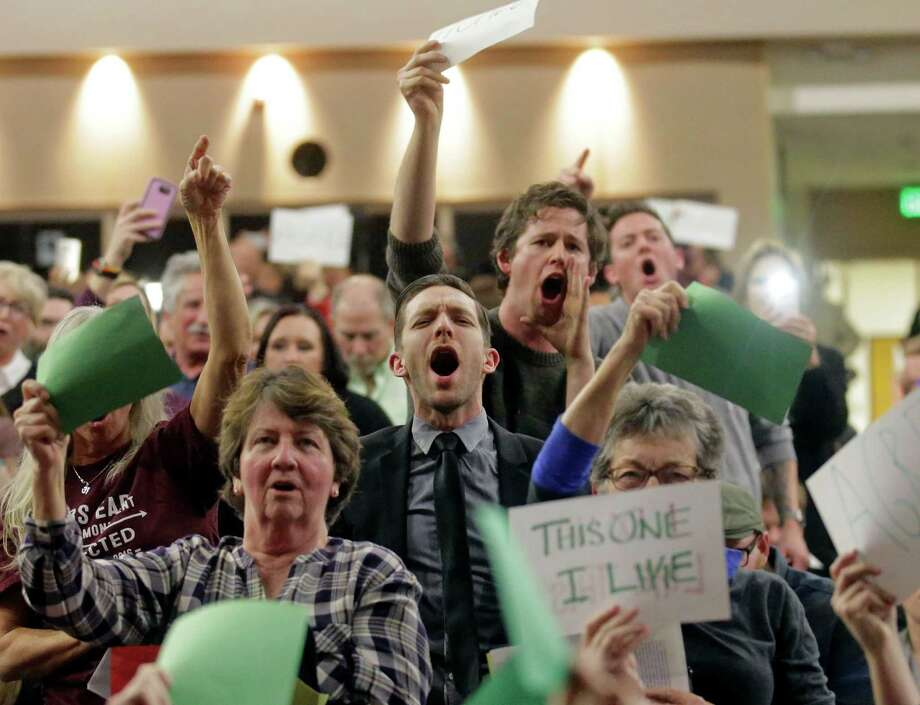 People shout at Rep. Jason Chaffetz during his Thursday town hall at Brighton High School in Cottonwood Heights, Utah. Many criticized the Republican's push to repeal newly named Bears Ears National Monument. Photo: Rick Bowmer, STF / Copyright 2017 The Associated Press. All rights reserved.