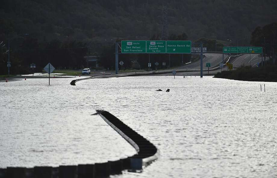 A section of State Route 37 in Novato flooded on Feb. 10, and at least 14 other days in 2017. Rising seas will inundate the road most days in the future. Photo: Josh Edelson, JOSH EDELSON / SAN FRANCISCO CHRONICLE