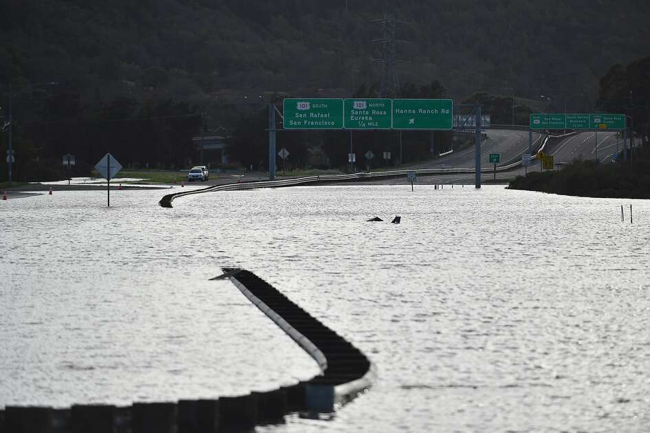 A flooded section of Highway 37 is seen in Novato, California on February 10, 2017. The road has been closed at least 14 days this winter due to flooding and extensive rain.