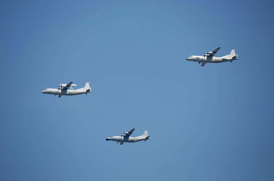 "FILE - In this Sept. 3, 2015 file photo, a KJ-200 airborne early warning and control plane, left, a Y-8J radar plane, center, and a Y-9JB radar plane, right, fly in formation during a parade commemorating the 70th anniversary of Japan's surrender during World War II in Beijing. The U.S. Pacific Command says a Chinese aircraft and a U.S. Navy patrol plane had an ""unsafe"" encounter over the South China Sea this week, raising concerns. Pacific Command spokesman Robert Shuford said Friday, Feb. 10, 2017, that the ""interaction"" between a Chinese KJ-200 early warning aircraft and a U.S. Navy P-3C plane took place on Wednesday, Feb. 8, in international airspace over the waters. (AP Photo/Mark Schiefelbein, File) Photo: Mark Schiefelbein, STF / Copyright 2017 The Associated Press. All rights reserved."