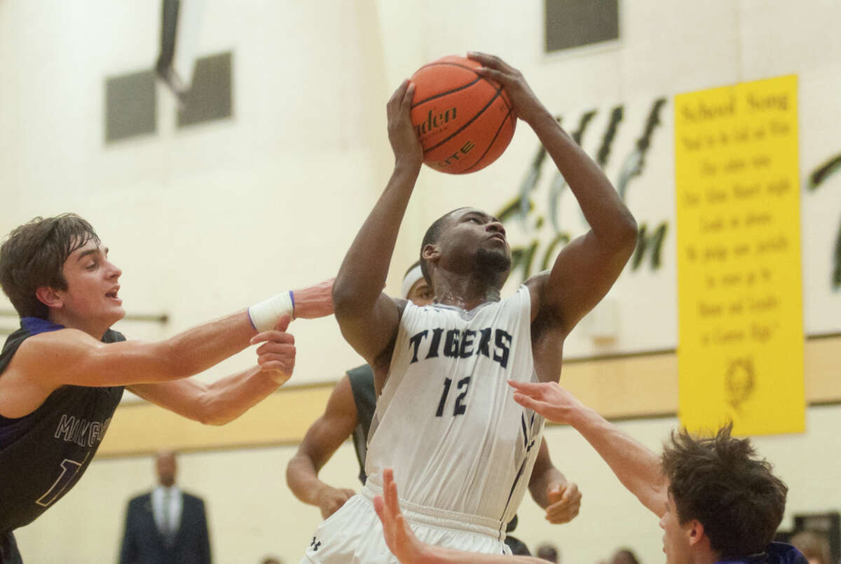 Conroe's Quentin Brown goes to the basket against Montgomery on Friday at Conroe High School.