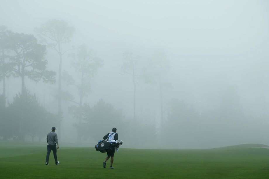 Jordan Spieth, left, finished his second round Friday just before the horn sounded to suspend play because of fog at the AT&T Pebble Beach Pro-Am. Photo: Jeff Gross, Stringer / 2017 Getty Images