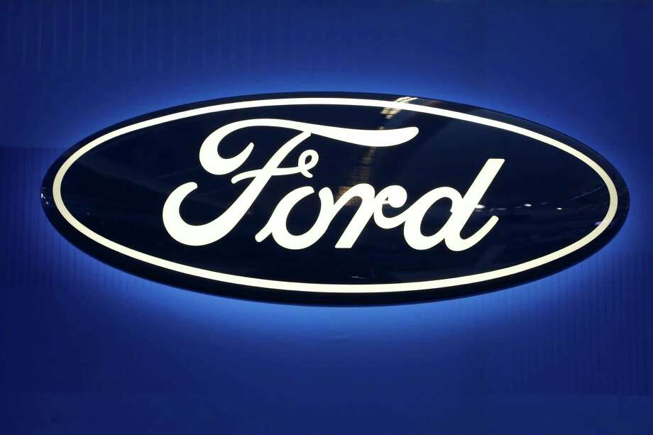 FILE - This Feb. 11, 2016, file photo shows the Ford logo on display at the Pittsburgh International Auto Show in Pittsburgh.  Ford Motor will spend $1 billion to take over a robotics startup to acquire more of the expertise needed to reach its ambitious goal of having a fully driverless vehicle on the road by 2021. The big bet announced Friday, Feb. 10, 2017,  comes just a few months after the Pittsburgh startup, Argo AI, was created by two alumni of Carnegie Mellon University's robotics program, Bryan Salesky and Peter Rander.(AP Photo/Gene J. Puskar, File) Photo: Gene J. Puskar, STF / Copyright 2016 The Associated Press. All rights reserved.
