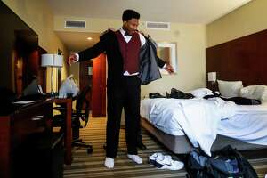 as Myles Garrett was fitted for a tuxedo in his hotel room by Arthur Warnock, of Al's Formal Wear, Friday, February 10, 2017. ( Karen Warren / Houston Chronicle )