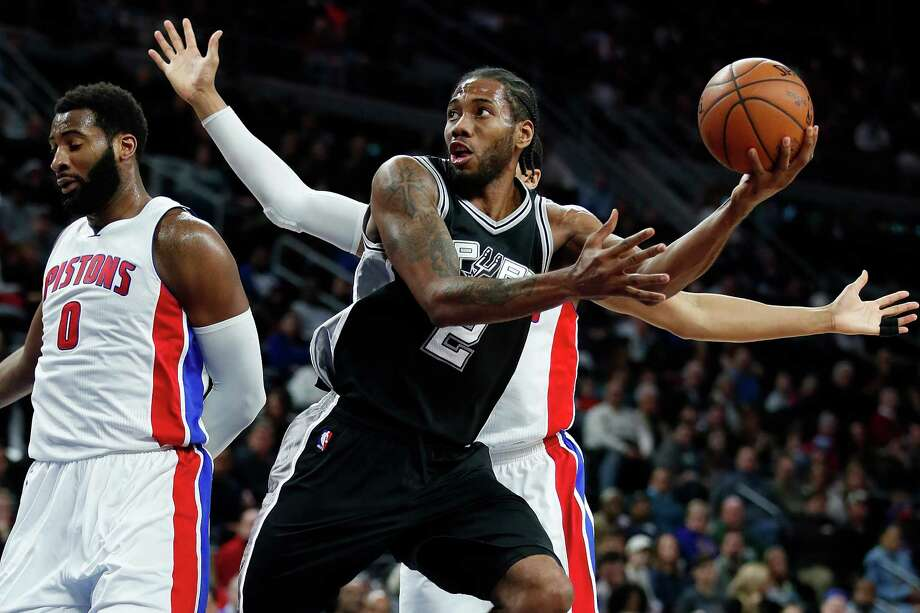 AUBURN HILLS, MI - FEBRUARY 10: Kawhi Leonard #2 of the San Antonio Spurs gets a second half shot off while playing the Detroit Pistons at the Palace of Auburn Hills on February 10, 2017 in Auburn Hills, Michigan. San Antonio won the game 103-92. NOTE TO USER: User expressly acknowledges and agrees that, by downloading and or using this photograph, User is consenting to the terms and conditions of the Getty Images License Agreement. Photo: Gregory Shamus, Getty Images / 2017 Getty Images