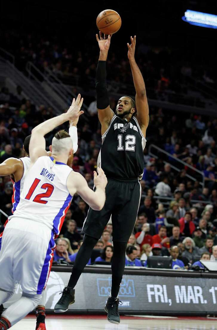 AUBURN HILLS, MI - FEBRUARY 10: LaMarcus Aldridge #12 of the San Antonio Spurs gets a shot off over Aron Baynes #12 of the Detroit Pistons during the second half at the Palace of Auburn Hills on February 10, 2017 in Auburn Hills, Michigan. San Antonio won the game 103-92. NOTE TO USER: User expressly acknowledges and agrees that, by downloading and or using this photograph, User is consenting to the terms and conditions of the Getty Images License Agreement.