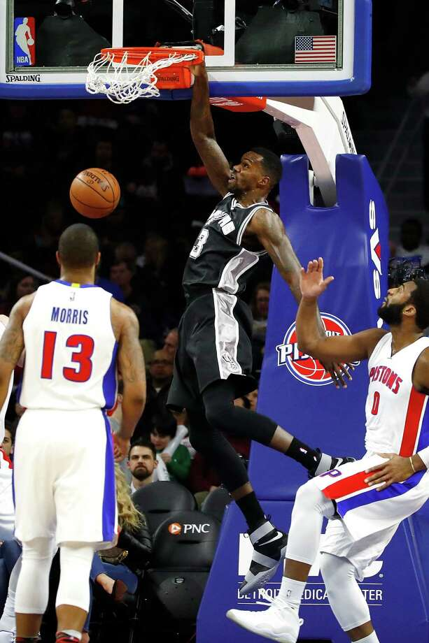 AUBURN HILLS, MI - FEBRUARY 10: Dewayne Dedmon #3 of the San Antonio Spurs gets a first half dunk between Marcus Morris #13 an Andre Drummond #0 of the Detroit Pistons at the Palace of Auburn Hills on February 10, 2017 in Auburn Hills, Michigan. San Antonio won the game 103-92. NOTE TO USER: User expressly acknowledges and agrees that, by downloading and or using this photograph, User is consenting to the terms and conditions of the Getty Images License Agreement. Photo: Gregory Shamus, Getty Images / 2017 Getty Images