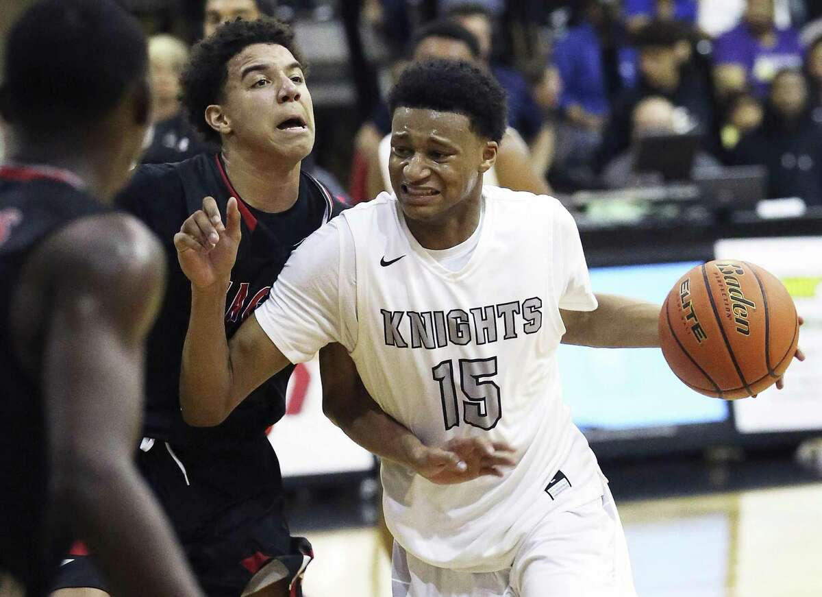 Steele's Gerald Liddell moves into the lane on Kevin McCullar as Steele hosts Wagner in boy's basketball on February 10, 2017.