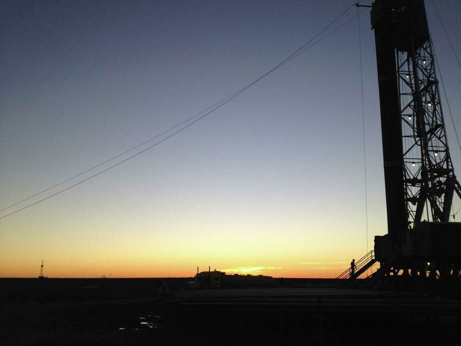 The setting sun silhouettes Parsley Energy's first hori-zontal well in the Permian Basin, drilled in 2013.