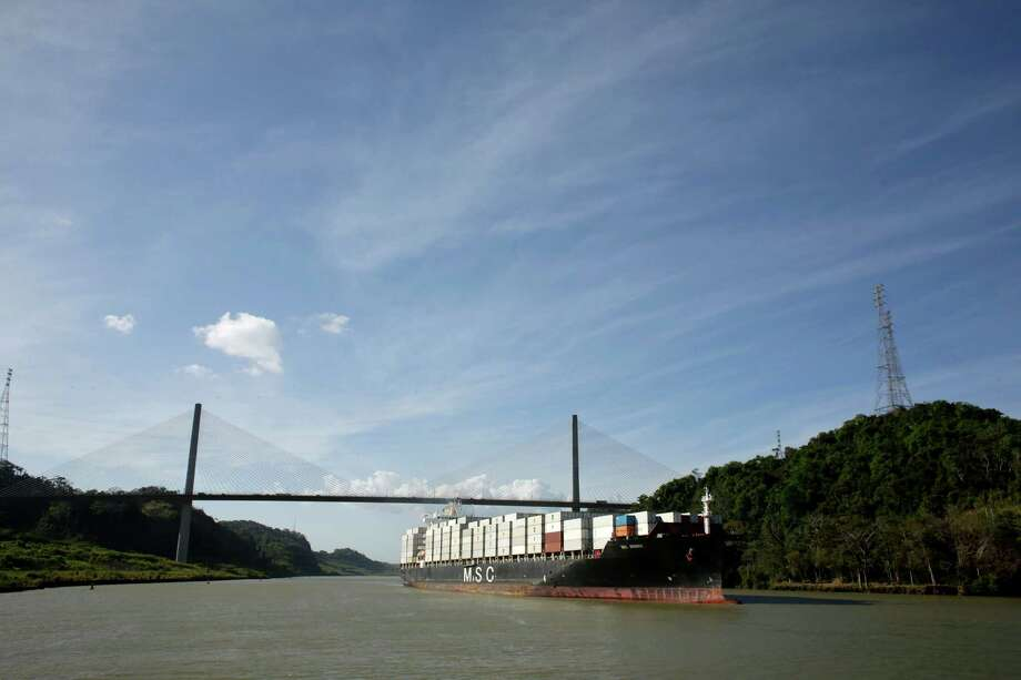 A cargo ship travels through the Culebra Cut in Paraiso, Panama. A Panama Canal Authority statement said nearly 800 so-called New Panamax ships have transited the locks since June, an average of 5.3 vessels per day.  Photo: Arnulfo Franco, STF / Copyright 2017 The Associated Press. All rights reserved.
