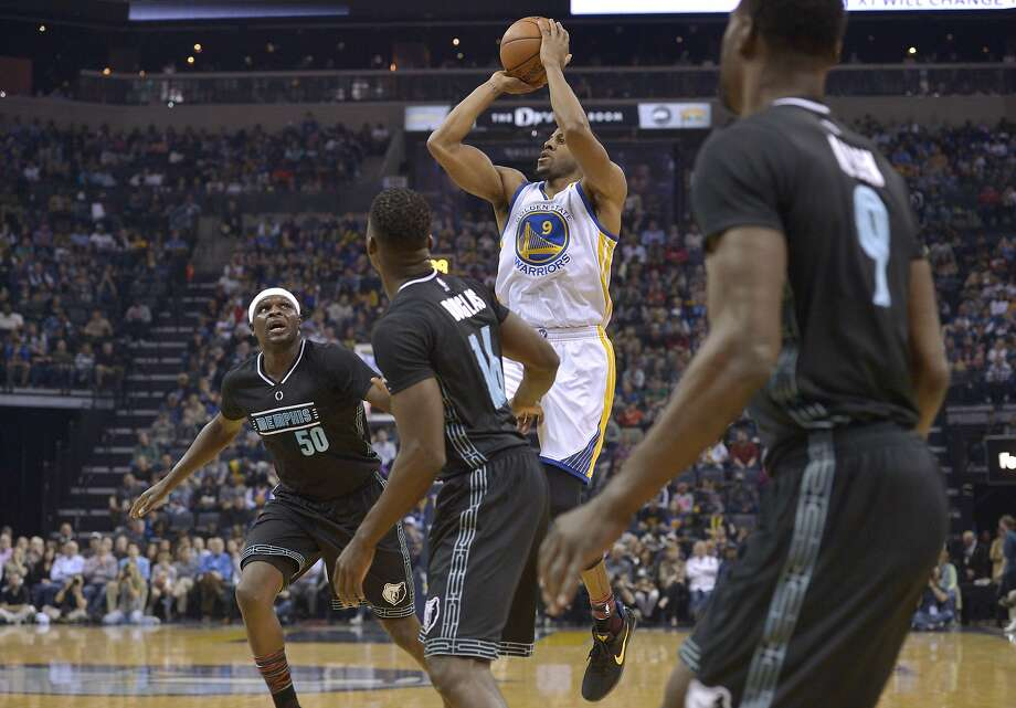 Golden State Warriors forward Andre Iguodala (9) shoots between Memphis Grizzlies forward Zach Randolph (50) and guards Toney Douglas (16) and Tony Allen (9) during the first half of an NBA basketball game Friday, Feb. 10, 2017, in Memphis, Tenn. (AP Photo/Brandon Dill) Photo: Brandon Dill, Associated Press