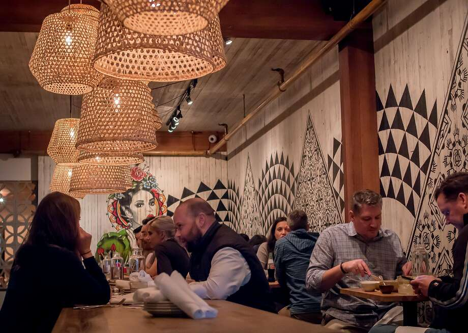 People have dinner at Flores in San Francisco. Photo: John Storey, Special To The Chronicle