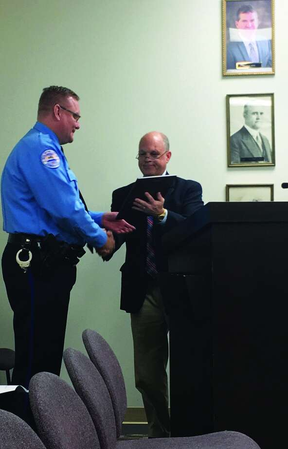 Edwardsville Police Chief Jay Keeven accepted the Officer Safety Award from SILEC Director David Hayes after having all Edwardsville officers complete the Project 16 training. The trainings promote officer safety during certain encounters when on-the-job. Photo: Cody King • Intelligencer