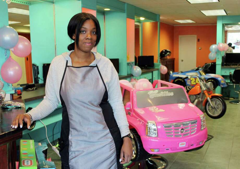 Melisha Newell, of Ansonia, inside her new salon, Super Scissors, at 1 Danbury Road in Wilton. Photo: Stephanie Kim / Hearst Connecticut Media