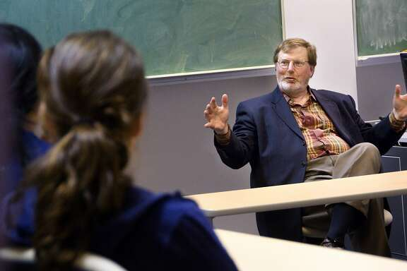 In this 2008 photo provided by Whitman College, U.S. District Judge James Robart, right, talks with students at the college in Walla Walla, Wash. Robart ruled Friday, Feb. 3, 2017, in federal court in Seattle to suspend President Donald Trump's travel and refugee ban. (Greg Lehman/Whitman College via AP)