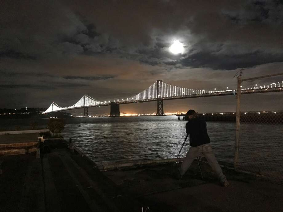Some people went to great lengths to get a good look at Feb. 10's full moon over the San Francisco Bay. Photo: Ted Andersen