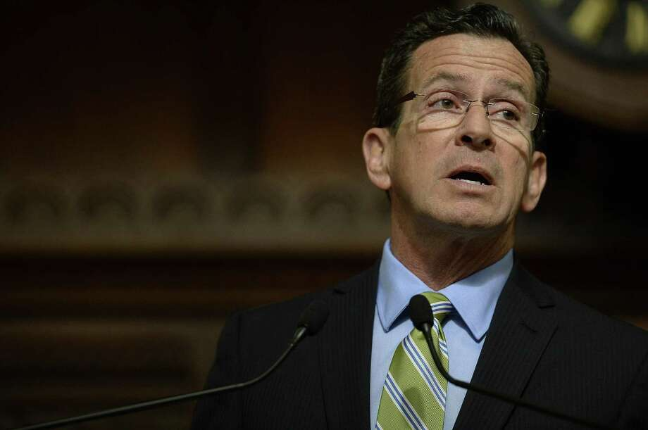 Connecticut Gov. Dannel P. Malloy delivers his budget address to members of the house and senate inside the Hall of the House at the state Capitol in Hartford, Conn., Wednesday, Feb. 8, 2017. (AP Photo/Jessica Hill) Photo: Jessica Hill / Associated Press / AP2017