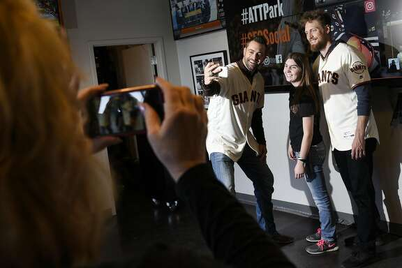 Mikayla Massa of Chico poses with Hunter Pence, right, and Jeremy Affeldt in the Social Media Cafe as the San Francisco Giants hold their FanFest event at AT&T Park in San Francisco, CA, on Saturday February 11, 2017.
