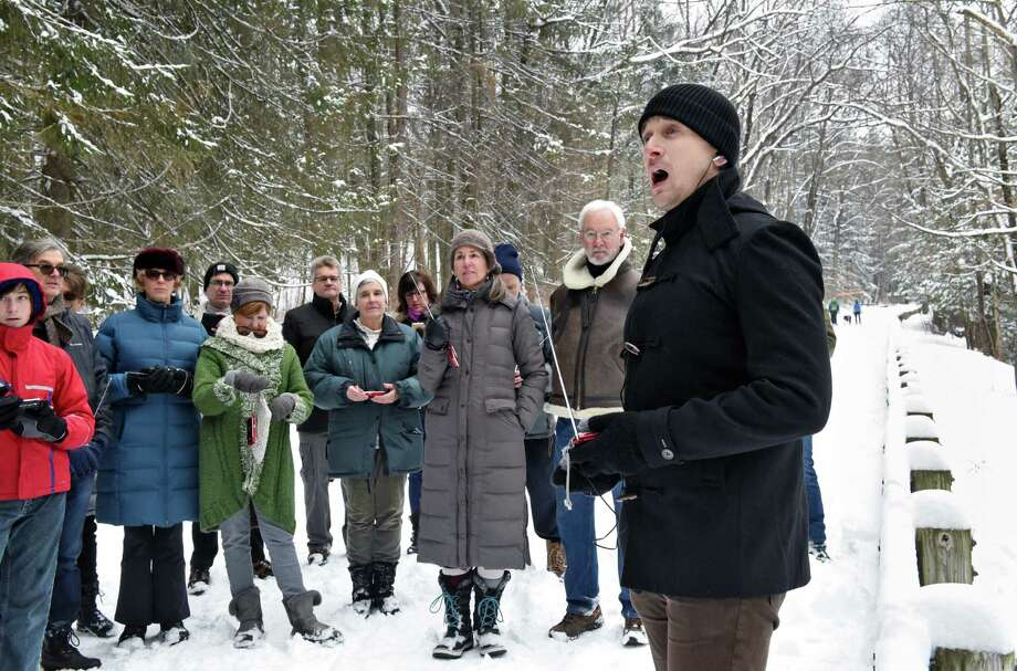 In partnership with Saratoga Spa State Park and Opera Saratoga, NYC baritone Christopher Dylan Herbert, right, performs Winterize, an outdoor adaptation of Franz Schubert's Winterreise, reimagined for baritone and transistor radios in Saratoga Spa State Park Saturday Feb.11, 2017 in Saratoga Springs, NY. (John Carl D'Annibale / Times Union) Photo: John Carl D'Annibale / 20039515A