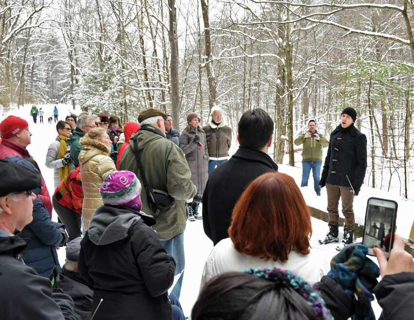 In partnership with Saratoga Spa State Park and Opera Saratoga, NYC baritone Christopher Dylan Herbert, right, performs Winterize, an outdoor adaptation of Franz Schubert's Winterreise, reimagined for baritone and transistor radios in Saratoga Spa State Park Saturday Feb.11, 2017 in Saratoga Springs, NY. (John Carl D'Annibale / Times Union)