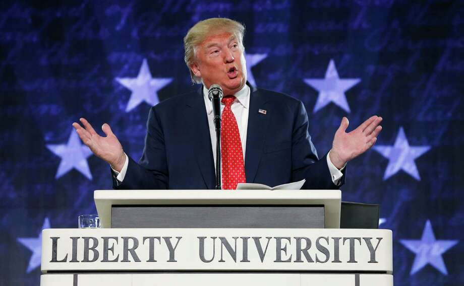 FILE - In this Jan. 18, 2016, file photo, Donald Trump gestures during a speech at Liberty University in Lynchburg, Va. Moving on a campaign promise, President Donald Trump said Thursday he will work for the repeal of the Johnson Amendment to free religious organizations from constraints on political activity (AP Photo/Steve Helber, File) Photo: Steve Helber, STF / Copyright 2017 The Associated Press. All rights reserved.