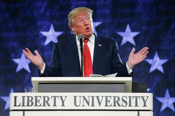 FILE - In this Jan. 18, 2016, file photo, Donald Trump gestures during a speech at Liberty University in Lynchburg, Va. Moving on a campaign promise, President Donald Trump said Thursday he will work for the repeal of the Johnson Amendment to free religious organizations from constraints on political activity (AP Photo/Steve Helber, File)