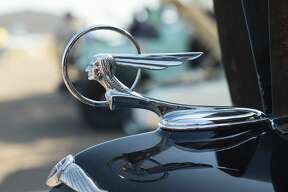 Custom car enthusiasts admired cars displayed by local and out of town car clubs on Saturday, February 11, 2017 during the WBCA Pipes and Stripes Car Show.
