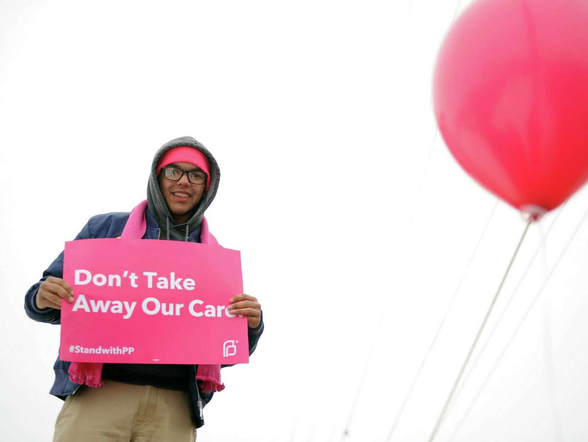 Advocates for Planned Parenthood rally at the organization's location on Central Avenue in Albany, N.Y. Saturday, Feb. 11, 2017. (Robert Downen/Times Union)