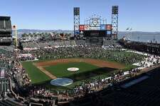 Fans fill the field as the San Francisco Giants hold their FanFest event at AT&T Park in San Francisco, CA, on Saturday February 11, 2017.
