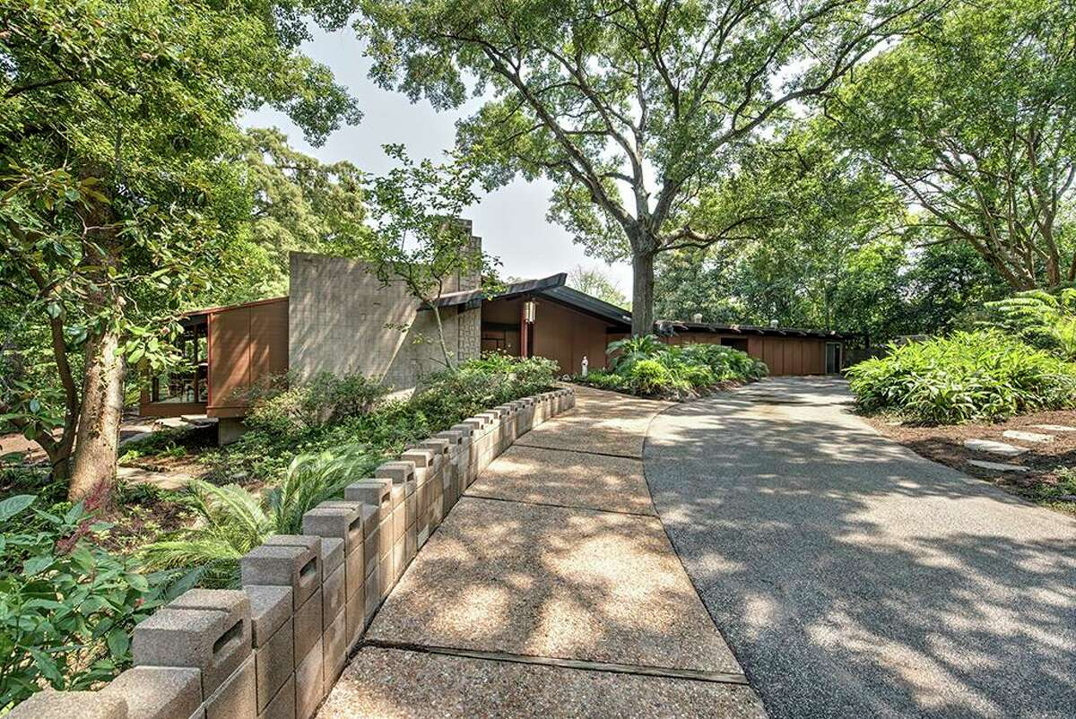 Notable architect Karl Kamrath designed the original home at 2 Tiel Way.