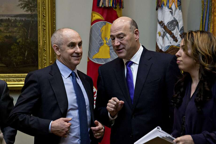 "Gary Cohn (center), director of the National Economic Council, says the White House ""can and must do better"" in consistently condemning hate groups. Photo: Andrew Harrer, Bloomberg"