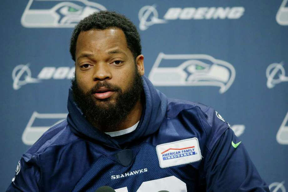 Seattle Seahawks defensive end Michael Bennett talks to reporters, Tuesday, Jan. 10, 2017, in Renton, Wash. The Seahawks will play the Atlanta Falcons in an NFL football NFC playoff game, Saturday, Jan. 14, 2017 in Atlanta (AP Photo/Ted S. Warren) Photo: Ted S. Warren, STF / Copyright 2017 The Associated Press. All rights reserved.