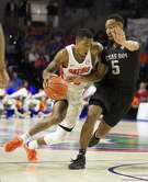 Florida guard Kasey Hill (0) dribbles past the defense of Texas A&M guard JC Hampton (5) during the second half of an NCAA college basketball game in Gainesville, Fla., Saturday, Feb. 11, 2017. Florida won 71-62. (AP Photo/Ron Irby)