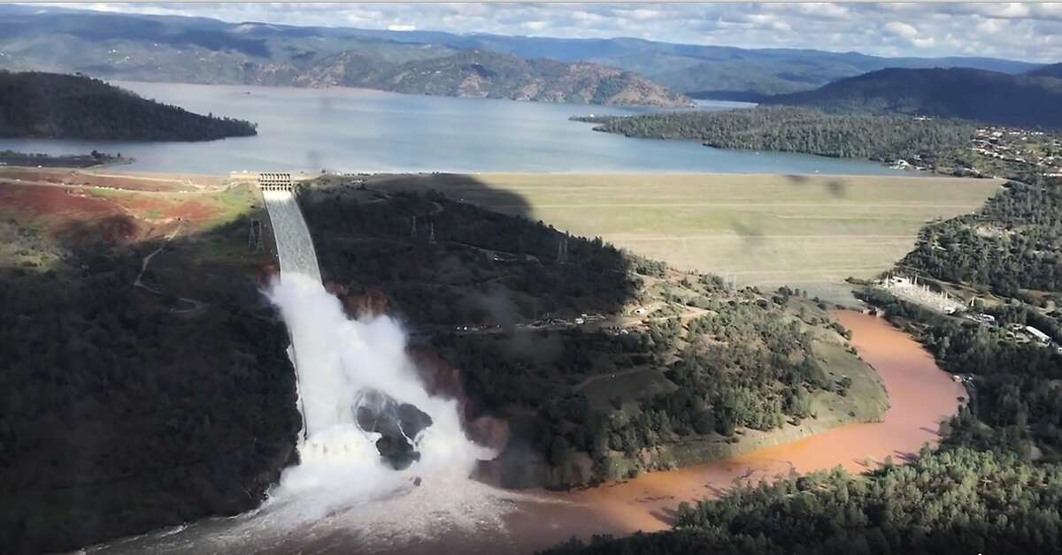 Water flows over the main spillway of the Oroville Dam during a helicopter tour.