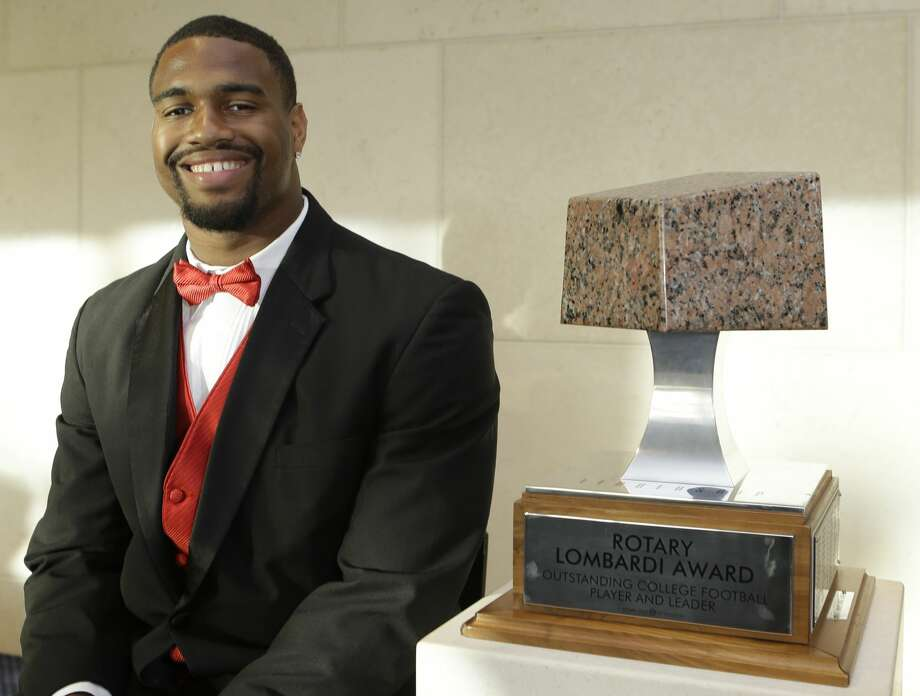 Jonathan Allen, University of Alabama, poses with the Rotary Lombardi Award at the Hobby Center,  800 Bagby, Saturday, Feb. 11, 2017, in Houston. The four Rotary Lombardi Award candidates are Jonathan Allen, University of Alabama, Lamar Jackson University of Louisville,  Jabrill Peppers University of Michigan, and Myles Garrett of Texas A & M University. ( Melissa Phillip / Houston Chronicle ) Photo: Melissa Phillip/Houston Chronicle