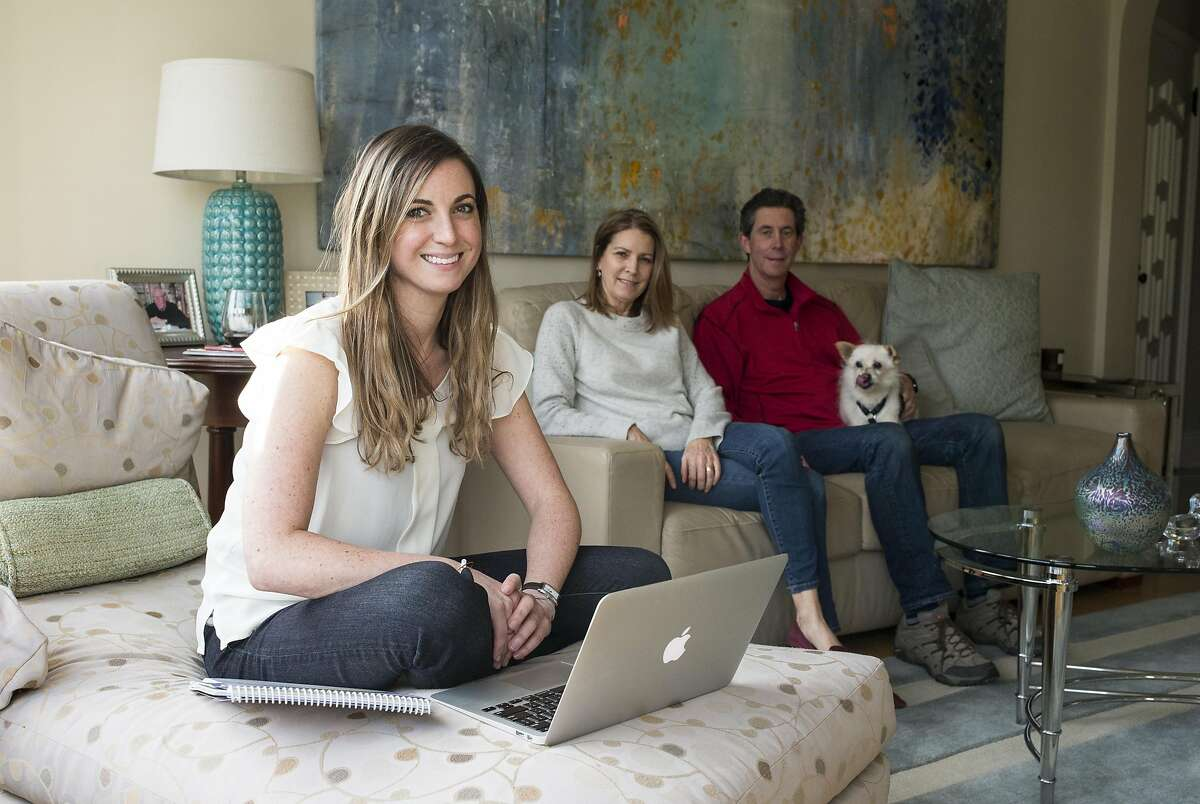 Hilary Elfman, a special education teacher at a city elementary school, sits for a portrait with her mom Holly Elfman and dad Rick Elfman (left to right) at her parent's apartment in San Francisco, Calif., on Friday, February 10, 2017.