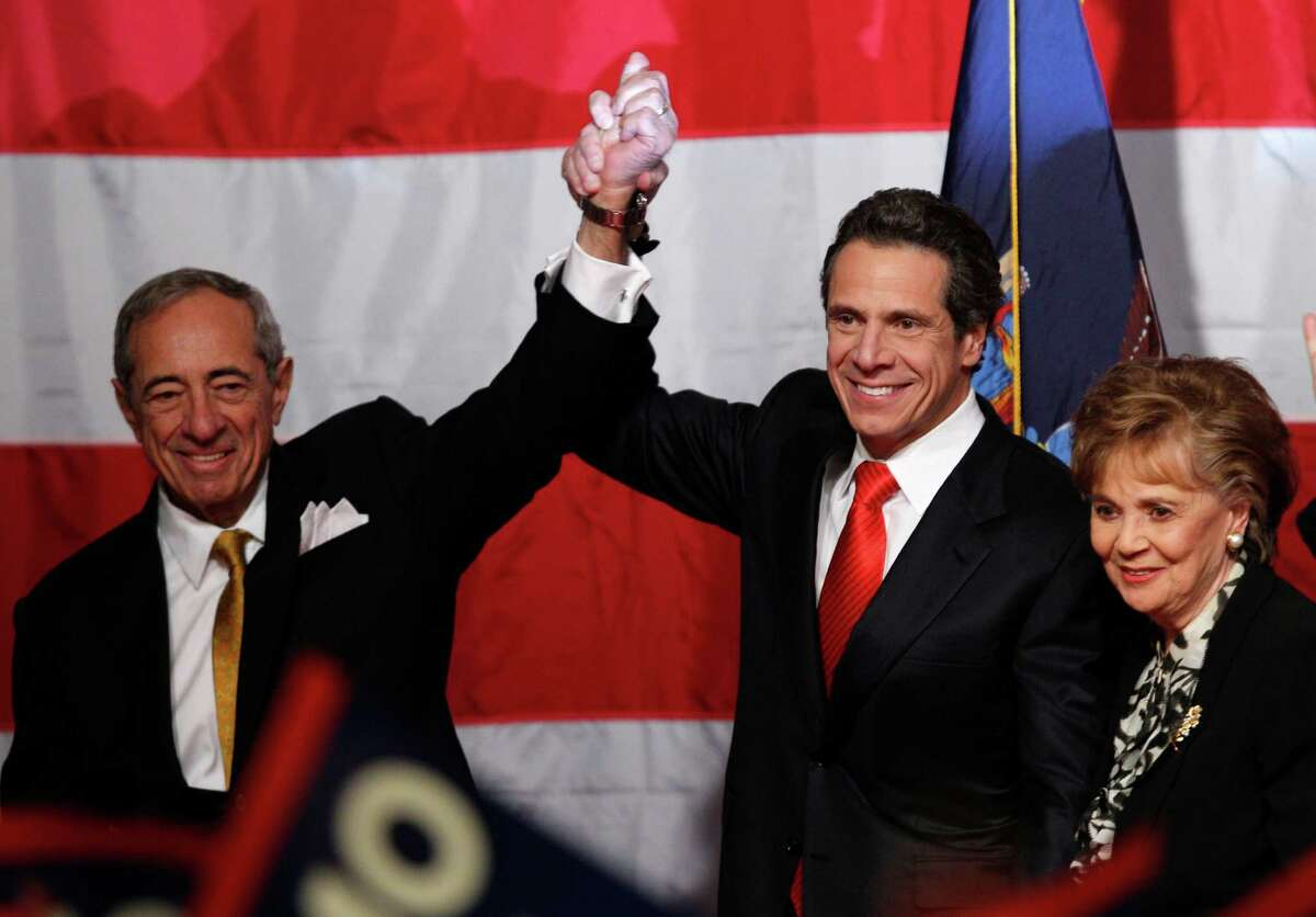 Gov.-elect Andrew Cuomo, his father, former Gov. Mario Cuomo, and his mother, Matilda, before giving his victory speech Tuesday, Nov. 2, 2010, in New York. (AP Photo/Kathy Willens)