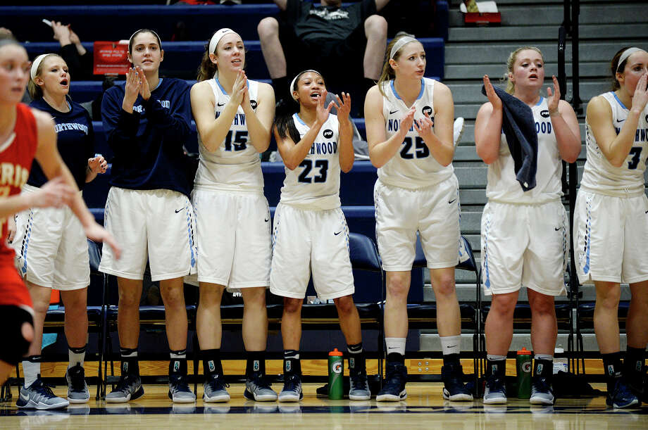 The Northwood bench celebrates during the third quarter of the Timberwolves' game against Ferris State on Saturday at Northwood University. Northwood won 55-50. Photo: NICK KING | Nking@mdn.net