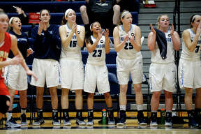 The Northwood bench celebrates during the third quarter of the Timberwolves' game against Ferris State on Saturday at Northwood University. Northwood won 55-50.