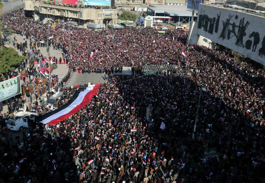 Followers of Iraq's influential Shiite cleric Muqtada al-Sadr chant slogans as they wave national flags during a demonstration against corruption in Baghdad, Iraq, Saturday, Feb. 11, 2017. (AP Photo/ Karim Kadim) Photo: Karim Kadim, STF / Copyright 2017 The Associated Press. All rights reserved.