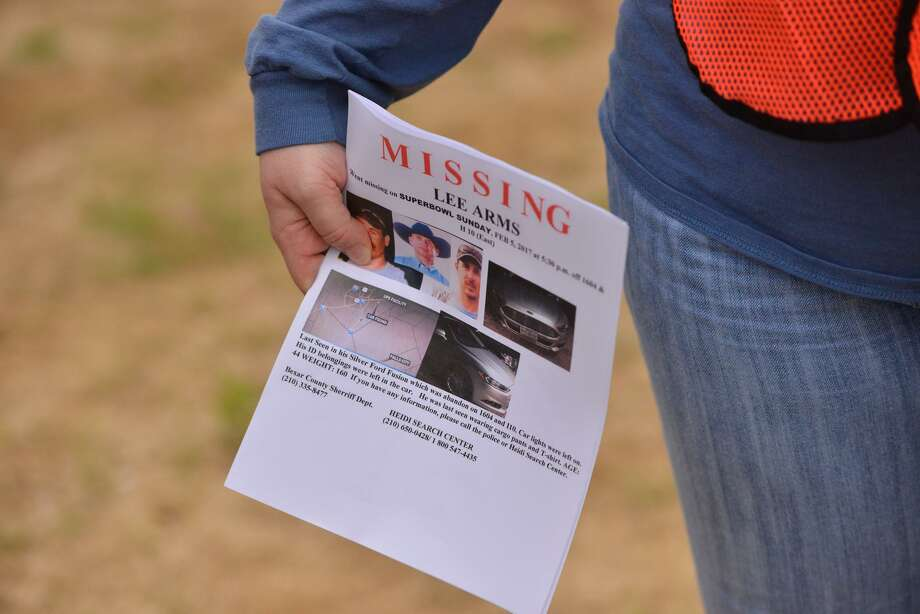 "Volunteers hold pamphlets as they begin searching for Walter ""Lee"" Arms Saturday morning near 1604 and I10. Arms disappeared Feb. 5. Photo: Robin Jerstad, Freelance / San Antonio Express News"