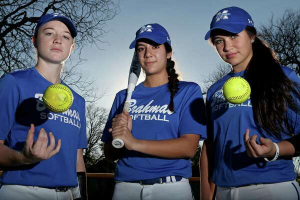Portrait of MacArthur softball players Kindell Brooks (from left), Kiersten Licea and Taylor Medina on Feb. 9, 2017 at the school.