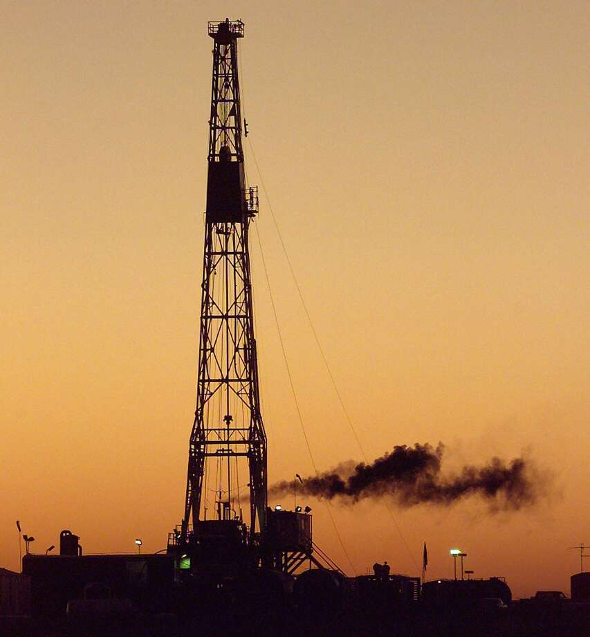 Explorers eager to tap the Permian Basin's mile-thick stack of oil-soaked rock layers have paid as much as $60,000 an acre — 10 times higher than in the Bakken of North Dakota. Photo: Associated Press /File Photo / MIDLAND REPORTER TELEGRAM