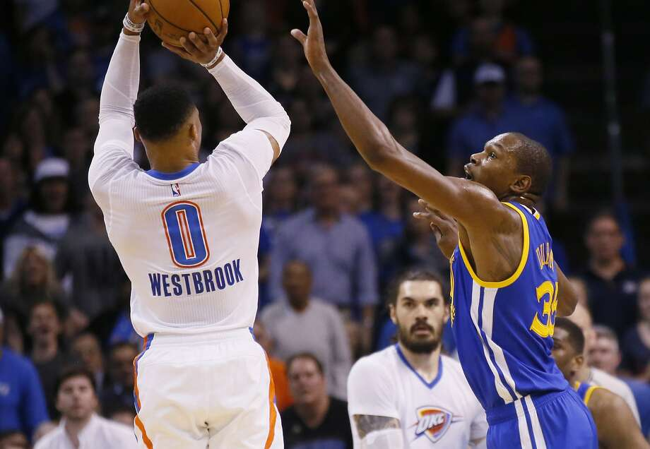 Oklahoma City Thunder guard Russell Westbrook (0) shoots over Golden State Warriors forward Kevin Durant, right, in the first quarter of an NBA basketball game in Oklahoma City, Saturday, Feb. 11, 2017. (AP Photo/Sue Ogrocki) Photo: Sue Ogrocki, Associated Press