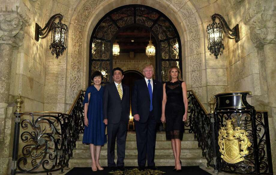 President Donald Trump, second from right, and first lady Melania Trump, right, stop to pose for a photo with Japanese Prime Minister Shinzo Abe, second from left, and his wife Akie Abe, left, before they have dinner at Mar-a-Lago in Palm Beach, Fla., Saturday, Feb. 11, 2017. (AP Photo/Susan Walsh) Photo: Susan Walsh, STF / Copyright 2017 The Associated Press. All rights reserved.