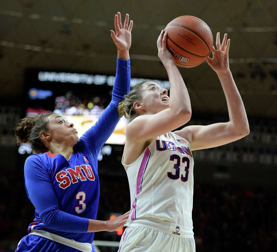 Connecticut's Katie Lou Samuelson goes up for two of her 19 first-half points against SMU's McKenzie Adams. Despite illness, Samuelson had a game-high 22. Photo: Jessica Hill, FRE / AP2017