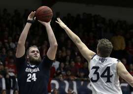 Gonzaga's Przemek Karnowski, left, shoots against Saint Mary's Jock Landale (34) during the first half of an NCAA college basketball game Saturday, Feb. 11, 2017, in Moraga, Calif. (AP Photo/Ben Margot)
