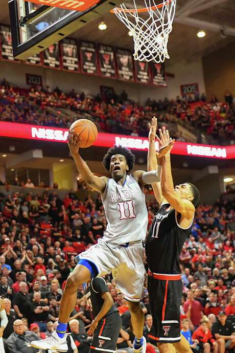Freshman Josh Jackson, who led Kansas with 31 points and 11 rebounds, charges to the basket against Texas Tech's Zach Smith on Saturday in Lubbock. Photo: John Weast, Stringer / 2017 Getty Images